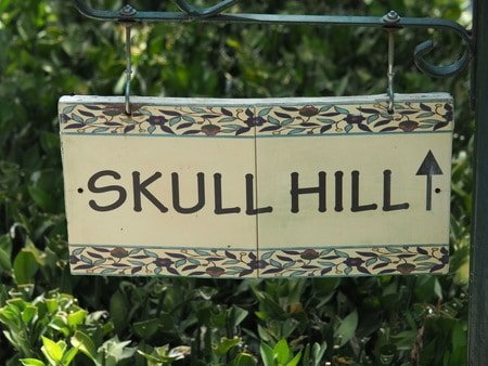 Skull Hill sign in Garden Tomb pointing to an overlook of Golgotha